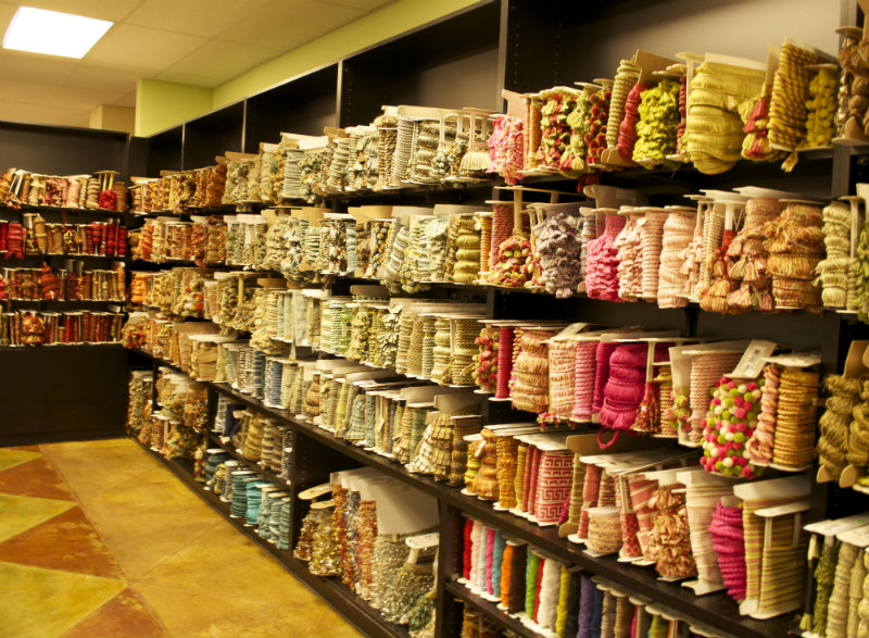 Walls lined with large selection of fabric trim at The Fabric House, online fabric store, buy fabric online, decorator fabric.